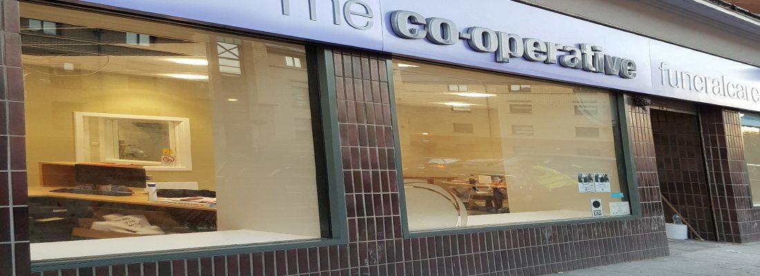 shop front respray COOP Funeralcare Tollcross
