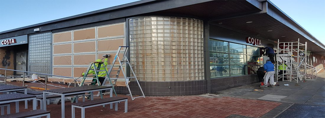 shop front spraying costa coffee